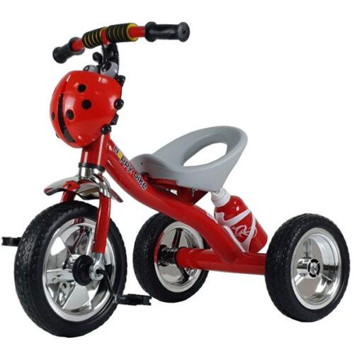 Crveni deciji tricikl sa bubamarom