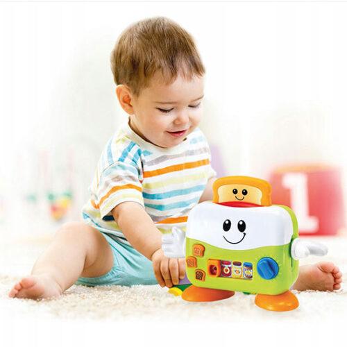 Vesela beba se igra sa bebi tosterom
