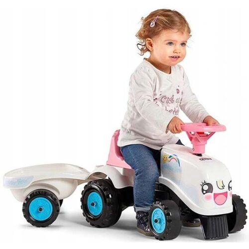 Devojcica vozi belu guralicu traktor
