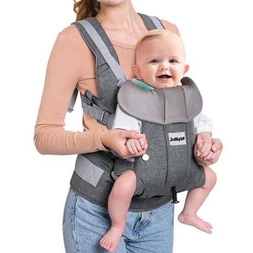 zena drzi bebu u nosiljci jungle